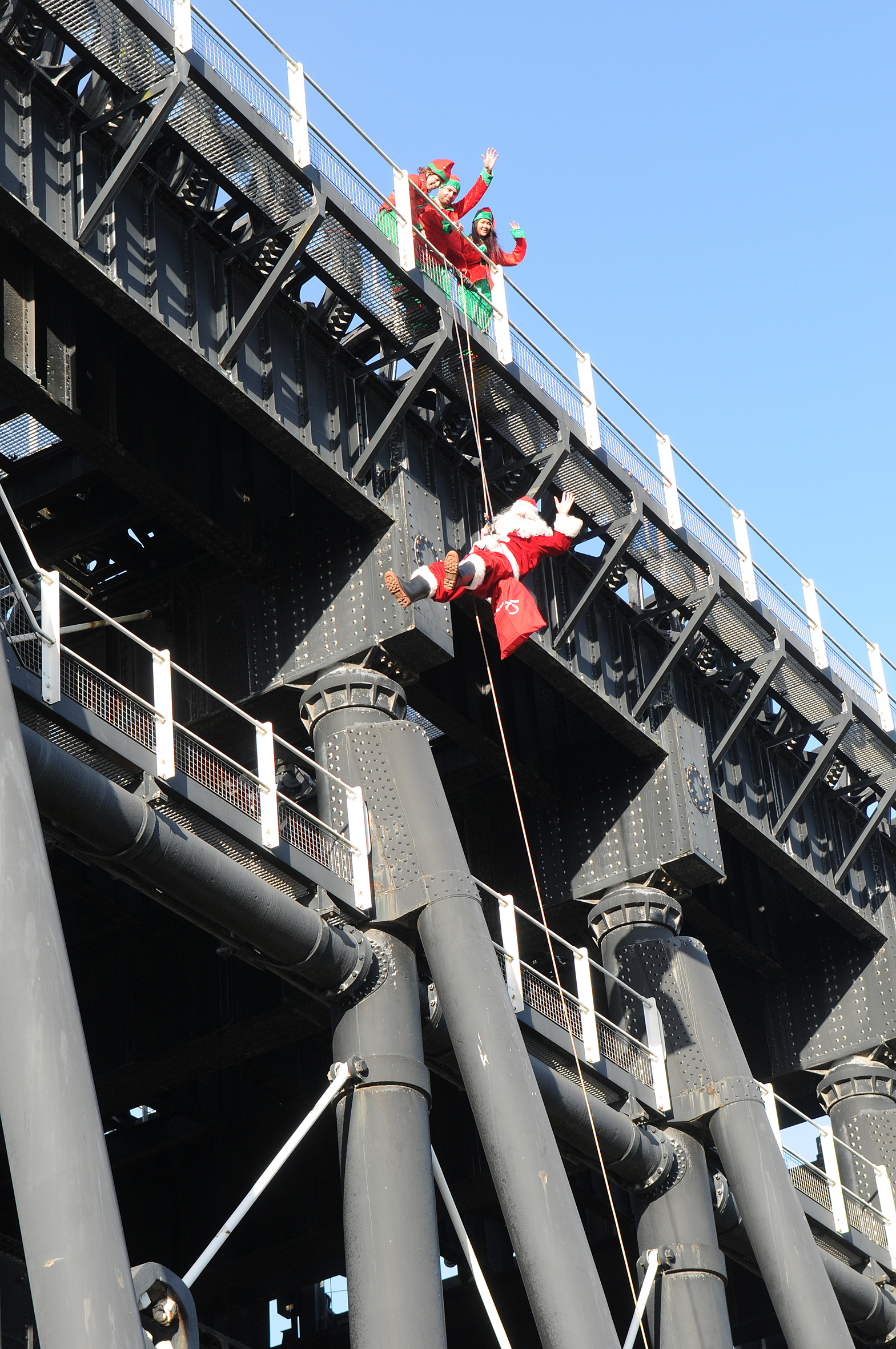 SANTA CLAUS PRACTICES HIS CLIMBING SKILLS  BY ABSEILING DOWN CHESHIRE'S GIANT CATHEDRAL OF THE CANAL