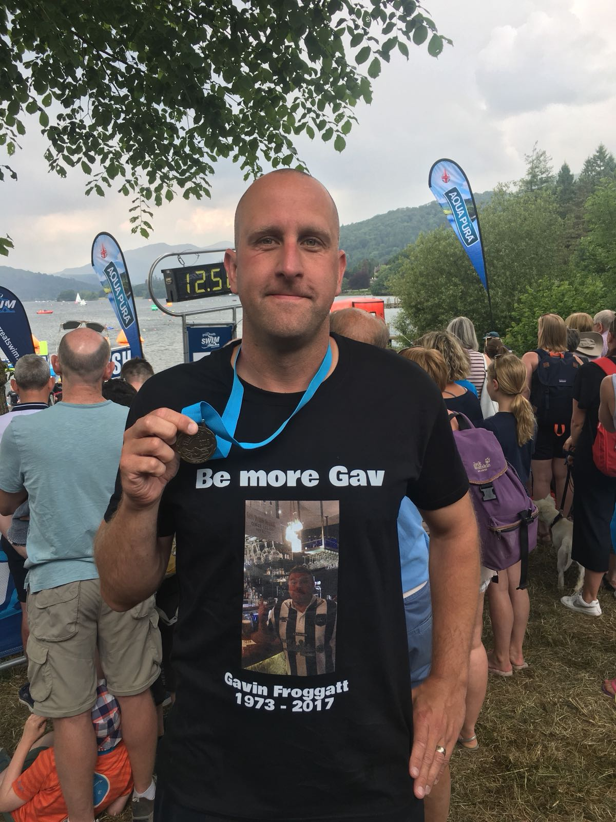 HEAD OF P.E. SWIMS WINDERMERE IN MEMORY OF FRIEND